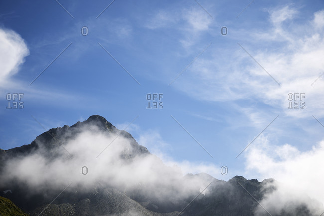 Silhouette of a rocky ridge in Ossau Valley, Pyrenees in France.
