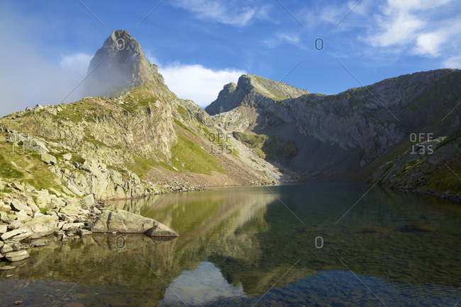 Arrious Peak and Lake in Ossau Valley, Pyrenees in France.