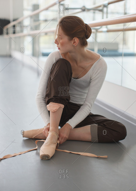 Cute ballerina preparing to rehearsal  in choreography class