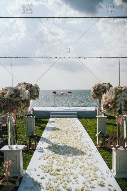 A wedding aisle at a beachfront ceremony overlooking the Andaman Sea in Phuket, Thailand