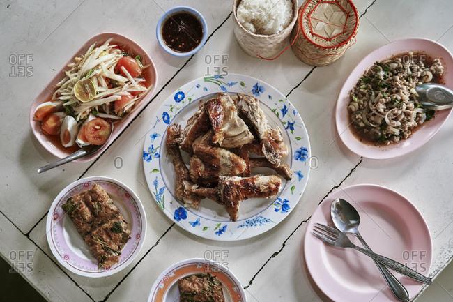 Grilled chicken, papaya salad and other dishes at a restaurant in Buriram town, northeastern Thailand