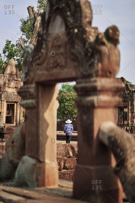Tourist walking on the grounds of the ancient Khmer temple, Prasat Muang Tam, in Buriram Province, in northeastern Thailand