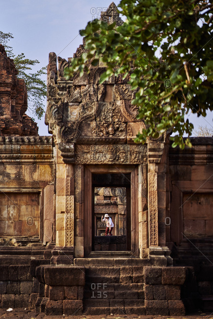 Buriram, Thailand - February 18, 2020: Tourist exploring the grounds of the ancient Khmer temple, Prasat Muang Tam
