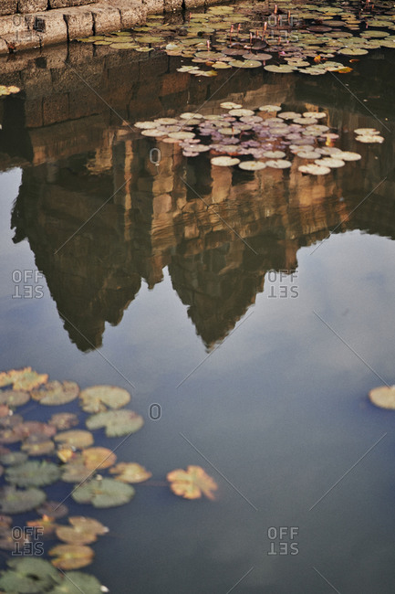The ancient Khmer temple, Prasat Muang Tam reflecting in pond in Buriram Province, in northeastern Thailand