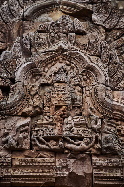 Detailed Khmer carvings on an arched doorway at Phanom Rung temple in Buriram Province in Thailand