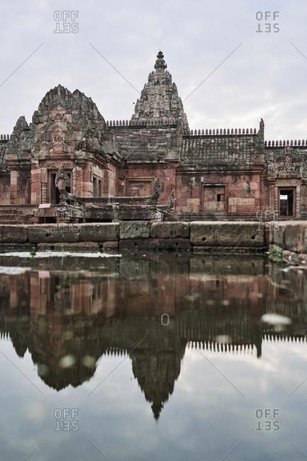Hindu Khmer Empire temple complex Phanom Rung reflecting in pond in Buriram Province, Thailand
