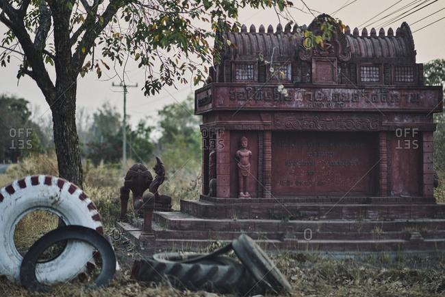 Buriram, Thailand - February 19, 2020: Strange signposts and Khmer carvings along the roadside in Buriram Providence