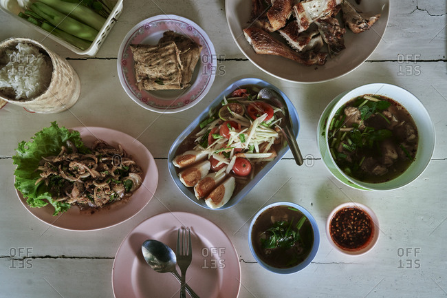 Papaya salad, tom saep soup, grilled chicken and more at a restaurant in Thailand