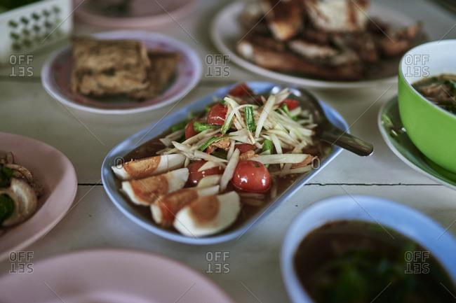 Papaya salad with salted eggs at a restaurant in Buriram, Thailand