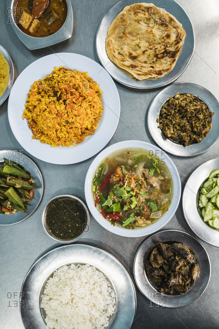 Biryani, okra, beef brain curry, and other dishes at a Thai-Muslim restaurant in Bangkok, Thailand