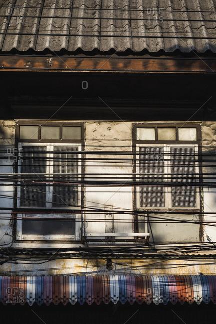 The facade of an old shophouse in Bangkok's old town, Thailand