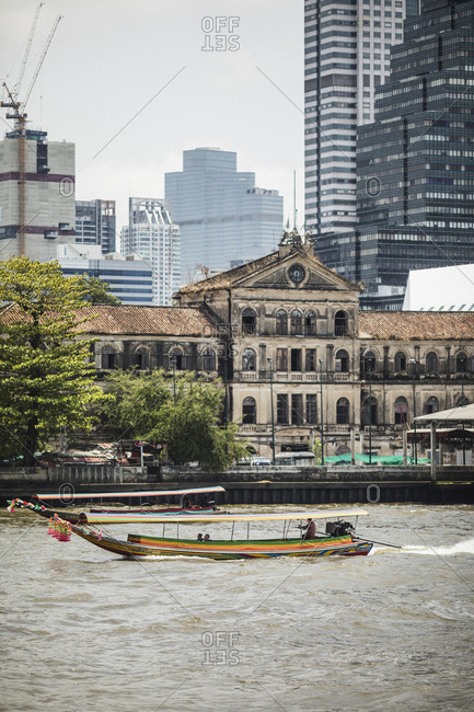 Bangkok, Thailand - April 5, 2019: A view of the old customs house over the Chao Phraya river in Bangkok, Thailand