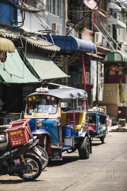 Bangkok, Thailand - April 5, 2019: A tuk tuk parked along a small side street in Bangkok