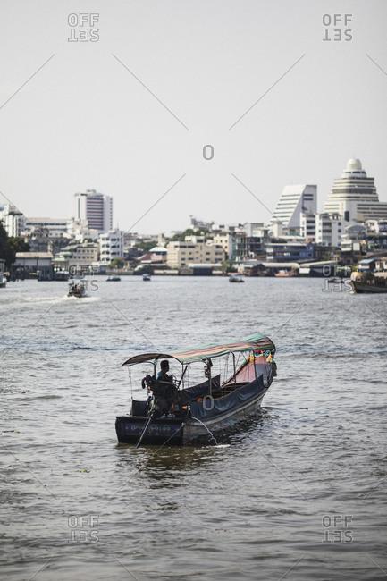 Bangkok, Thailand - April 5, 2019: A small boat on the Chao Phraya river in Bangkok