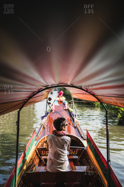Bangkok, Thailand - April 5, 2019: A longtail boat journey through Bangkok's maze of canals and waterways