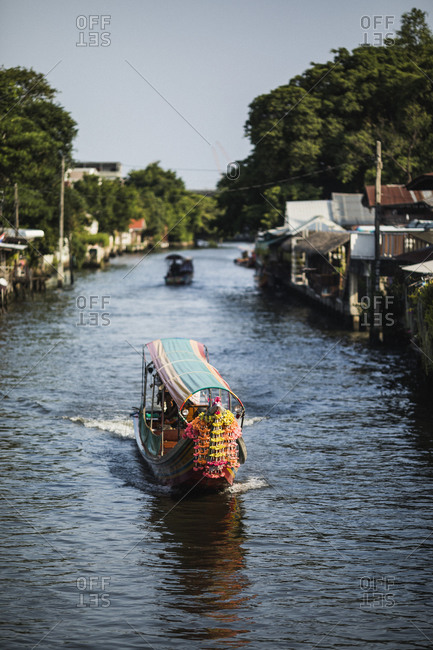 A longtail boat makes its way through Bangkok's maze of canals and waterways
