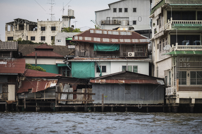 Ramshackle houses along the Chao Phraya river and its waterways in Bangkok, Thailand