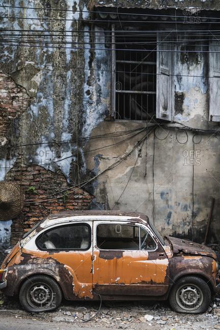 Bangkok, Thailand - April 5, 2019: An old car and house in the Talad Noi neighborhood