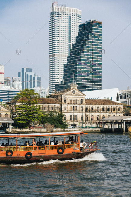 Bangkok, Thailand - April 18, 2019: A view of the old customs house over the Chao Phraya river in Bangkok