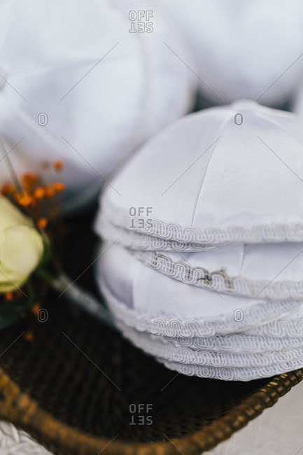 White yarmulkes at a traditional Jewish wedding