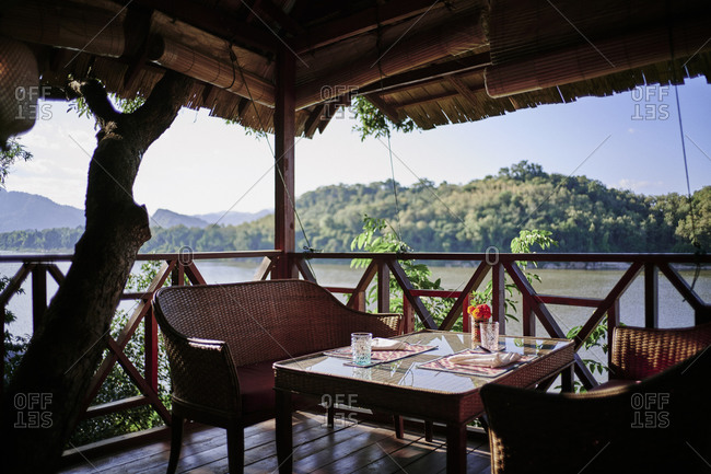 A small private dining area in a treetop loft at a villa in Luang Prabang, Laos