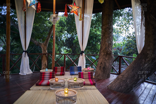 An outdoor seating area in a treehouse loft at a villa in Luang Prabang, Laos