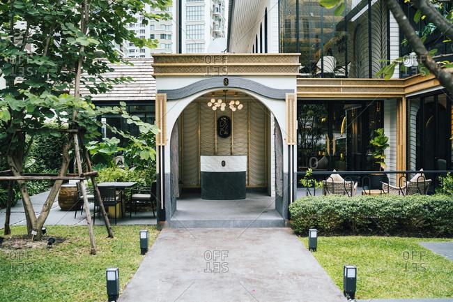 Bangkok, Thailand - December 12, 2018: The golden and green facade of Sorn restaurant in downtown Bangkok