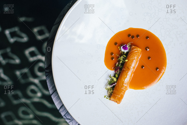 Cured salmon with carrot, bitter orange, and rice mayo at an upscale restaurant in Bangkok, Thailand