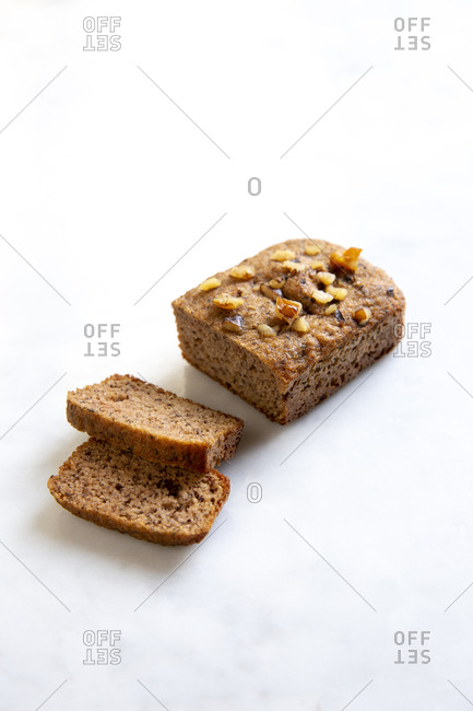 Mini banana bread loaf sliced on white marble