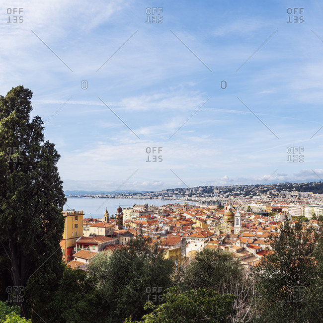 Nice, France - February 8, 2020: Panoramic view of the rooftops of the old town of Vieux Nice overlooking Baie de Anges