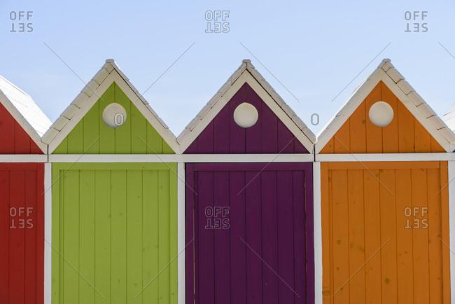 Colorful beach cabanas in seaside city of Le Lavandou, France