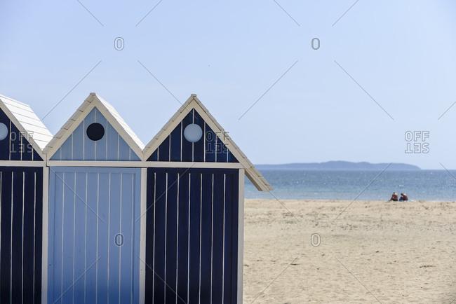 Blue beach cabanas in seaside city of Le Lavandou, France