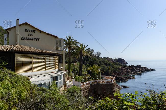 Saint-Raphael, France - April 20, 2018: Famous coastal restaurant Le Relais des Calanques and terraces overlooking Mediterranean Sea