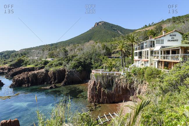 Saint-Raphael, France - April 20, 2018: Coastal restaurant and hotel Le Relais des Calanques and terraces overlooking Mediterranean Sea