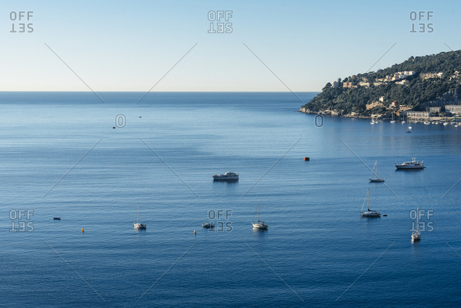 Sailboats and yachts in the bay and the harbor of Villefranche-sur-Mer and Cap de Nice, France