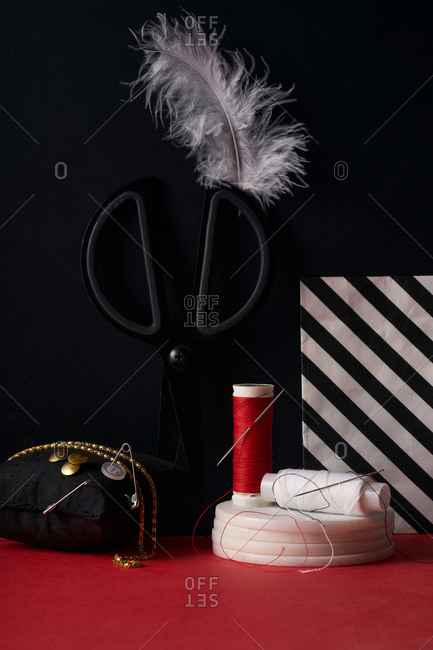 Sewing and craft items on a red and black background
