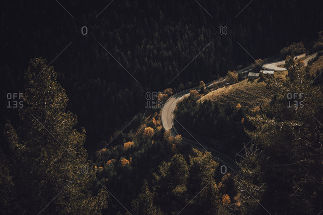 Road between the mountains surrounded by forest during autumn season Andorra