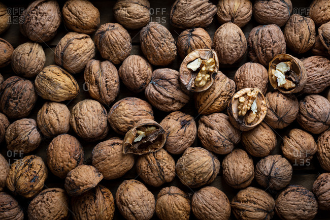 Overhead view of raw walnuts in shells