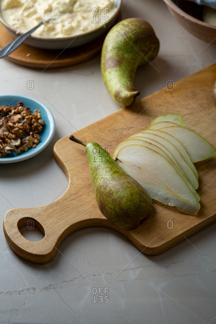 Sliced green pear on a wooden cutting board