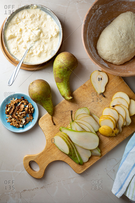 Sliced green and yellow pear and pie dough