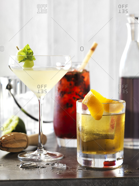 Three delicious cocktails just made and ready to be enjoyed.