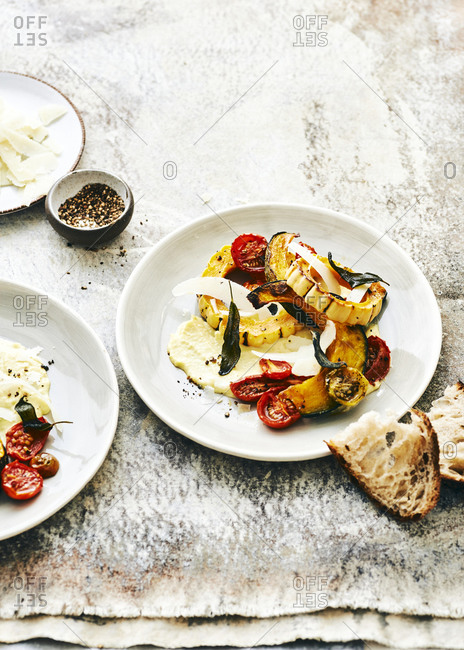 Autumn roasted vegetables on plates served with bread