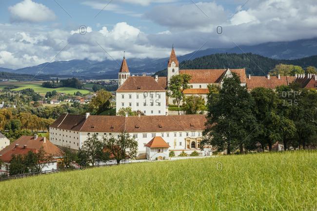 Austria- Carinthia-SanktPaulimLavanttal- Springtime meadow withSaint Paul's Abbey in background
