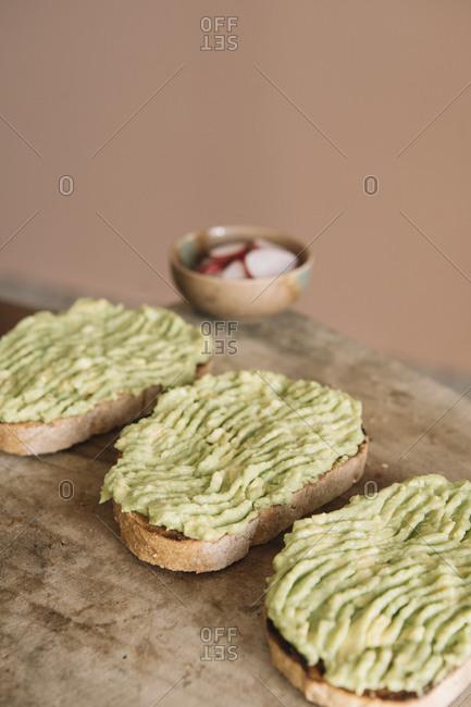 Guacamole spread on brown bread at kitchen