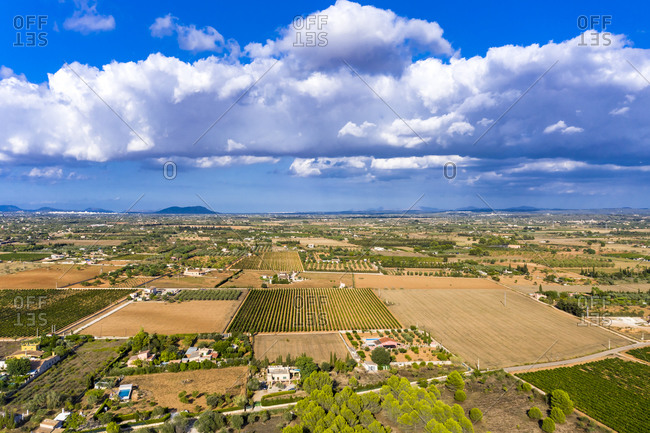Aerial view of agricultural fields against cloudy sky on sunny day- Mallorca- Spain