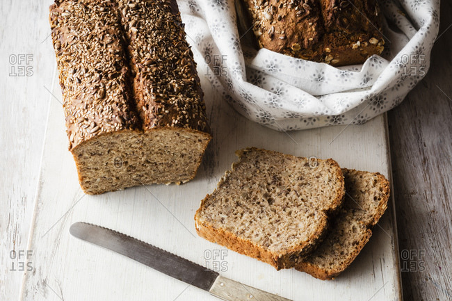 Home baked buckwheat bread and slices kept on cutting board