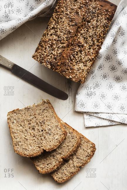 Homemade loaf of buckwheat bread kept on cutting board