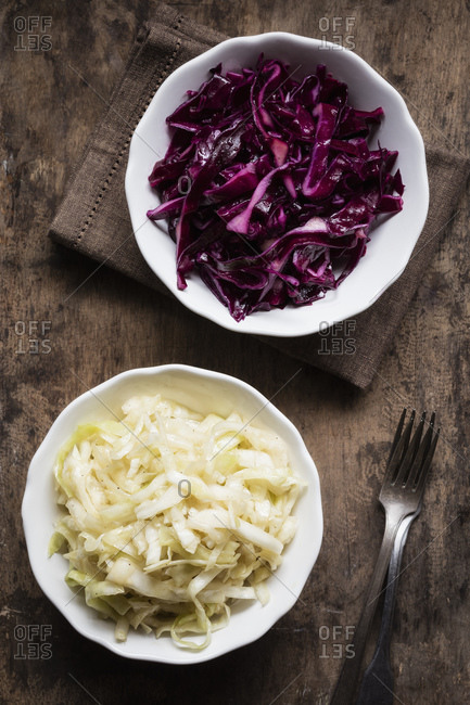 Bowl of red and white cabbage salad on table