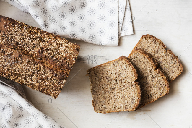 Buckwheat bread loaf with sliced bread kept on table