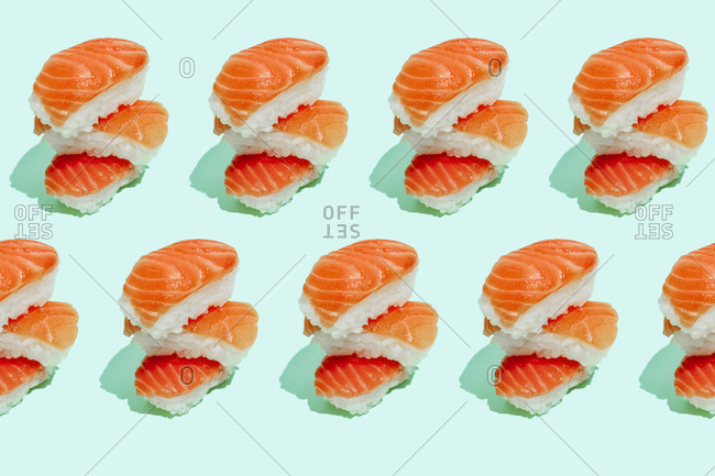 Multiple image of fresh salmon sushi nigiri on mint green background